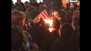 معارضون لترامب يحرقون علم أمريكا وسط هتافات 'ليس رئيسي' .. فيديو