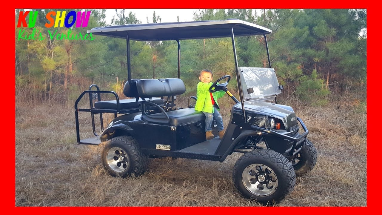 4 year old kid driving a gas powered lifted golf cart fun for the kids