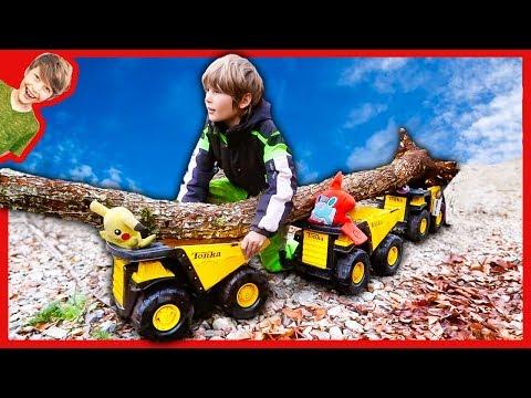 DUMP TRUCKS FOR CHILDREN HAULING A TREE!