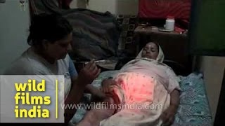Repeat youtube video Indian hijra injects insulin into her mother's thigh