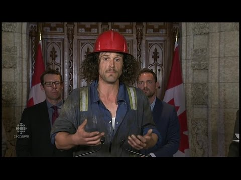 Oil rig worker, Bernard Hancock, delivers pro-oil petition to Ottawa