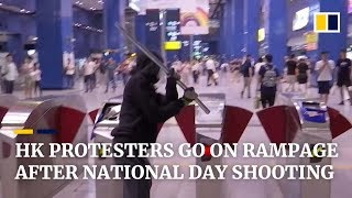 Hong Kong protesters go on rampage after National Day shooting