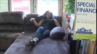 Sharita & Kelsie show the Ashley sectional w/ extras