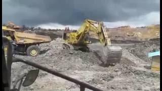 Excavator Loading Haul Dump Truck in Mining