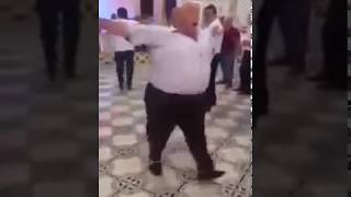 Fat man dancing funny at a wedding
