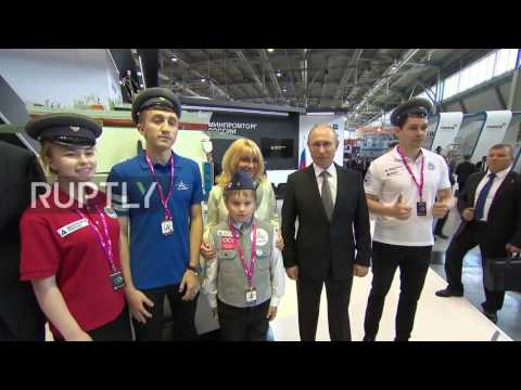 Russia: Students hand Putin hat of Tsarist-era engineers at Innoprom fair