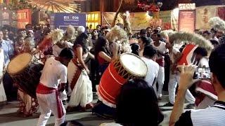 Durga Puja - Girls dance to the rhythm of the Dhak at Samaj Sevi