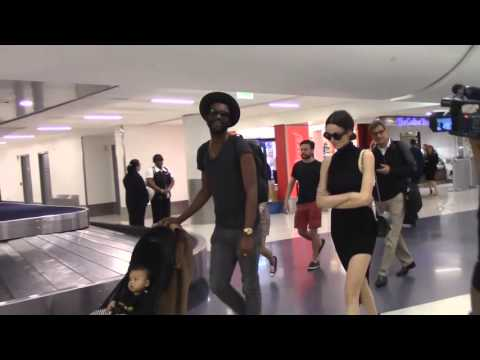 Gary Clark, Jr. And Parter Nicole Trunfio Arrive With Baby Zion At LAX