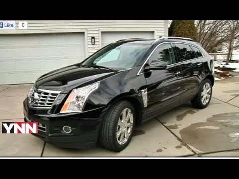 drive side w first autoblog cadillac video srx review view suv reviews
