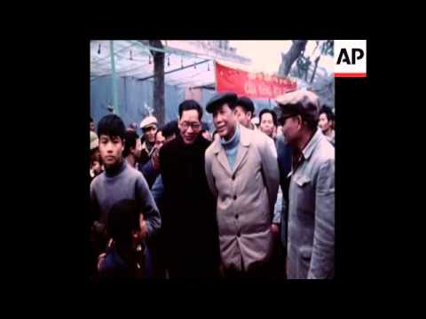 SYND  31-1-73 NORTH VIETNAMESE COMMUNIST PARTY SECRETARY VISITS REOPENED FLOWER MARKET
