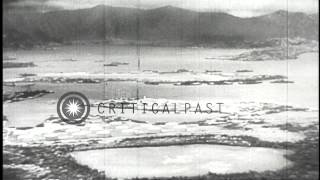 Japanese aircraft attack the United States Naval Base at Pearl Harbor in Hawaii, ...HD Stock Footage