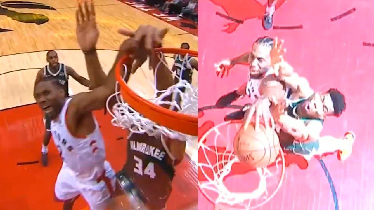 Kawhi Leonard dunk over Giannis Antetokounmpo   Bucks vs Raptors Game 4 image