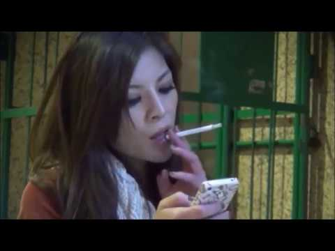 Japanese woman chain smokes all-white cigarettes