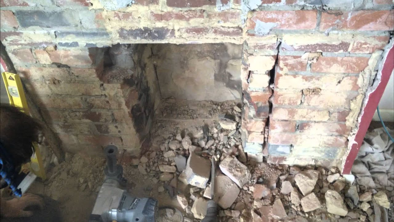 Breakout and widening of 1950s fireplace installation of