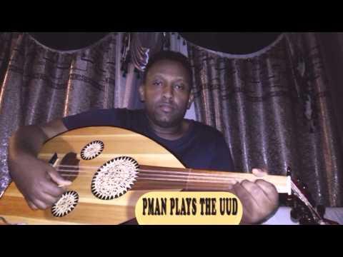 Pman plays the oud
