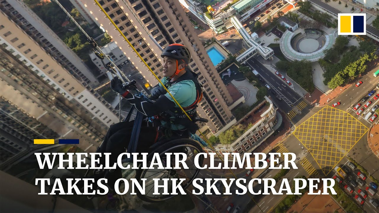 Hong Kong wheelchair climber Lai Chi-wai attempts to scale 320-meter skyscraper