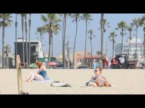 two girls relaxing on the beach in bikinis