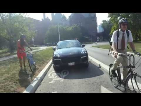 Toronto cyclists compete with vehicles on dedicated bike lanes