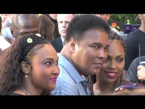 MUHAMMAD ALI Steps Out With Daughters To Attend Movie Premiere