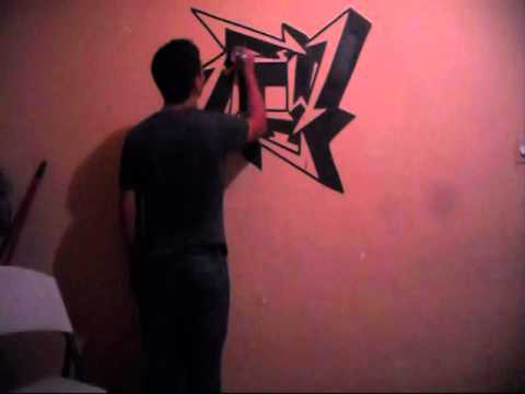 metallica logo grafiti, con un plumon en la pared ...