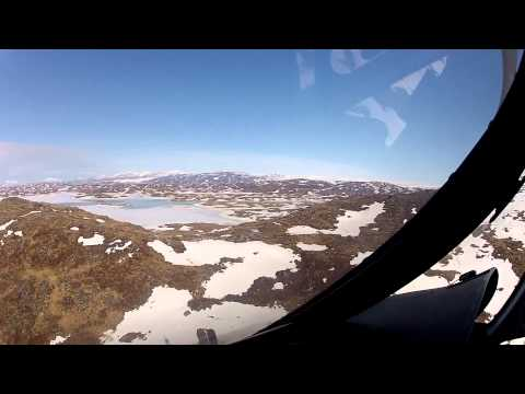 Flying from drilling site behind Isortoq mountain to Isortoq Reindeer Station
