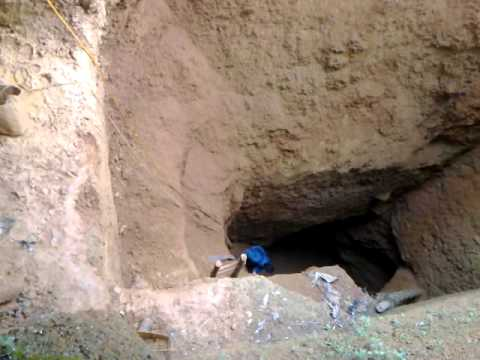 collapsed artisanal mine in congo, burying 3 a live