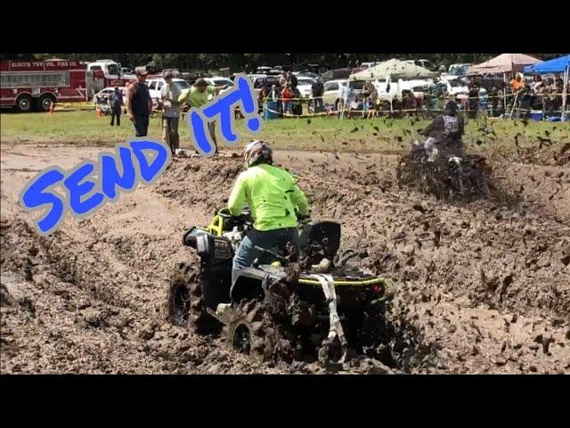 4Wheelers Racing Thru A Mud Bog