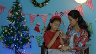 Beautiful mother gifting her daughter a special present on Christmas - festive season