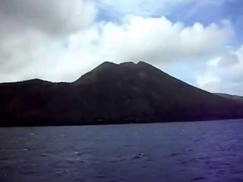 Mysterious Pagan Island viewed from a boat offshore - Micronesia