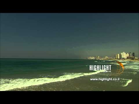 T 001 Israel Footage library: Tel Aviv stock footage - pan right from sea to shore.