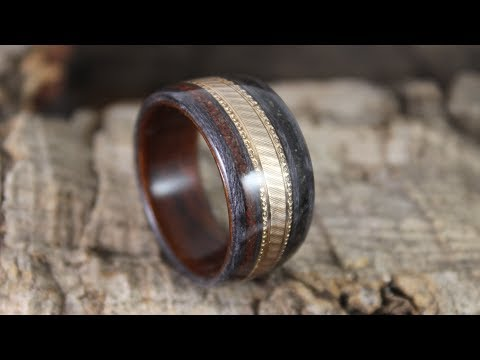 Gold Wedding Ring In A Wooden Ring