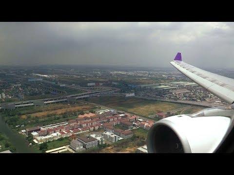 Thai Airways A330 landing in tropical rain at Bangkok Suvarnabhumi Airport