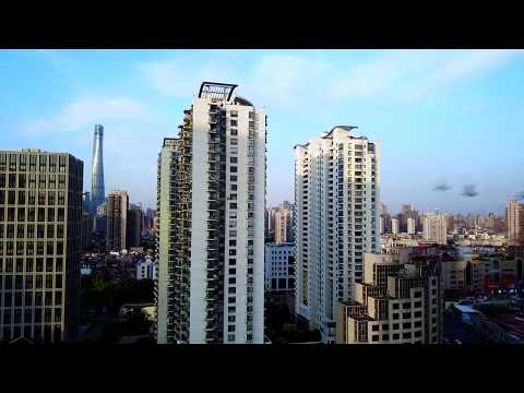 Drone Footage Window Start and Land 20th Floor Shanghai 4K