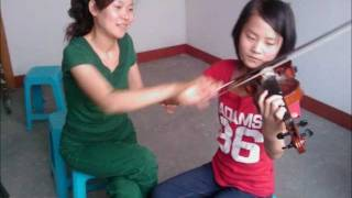 Me (Wenwen Han) and violin teacher