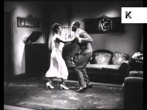 1930s African American Couple Jazz Dancing in Living Room