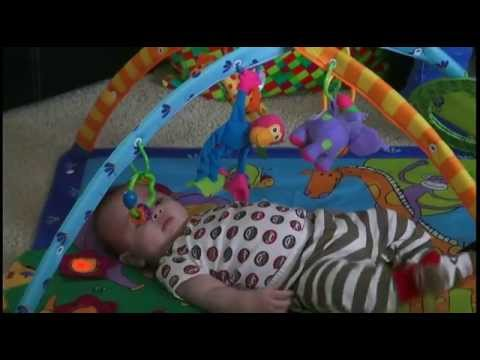 5 month old Baby Brian grabbing toys in musical gym