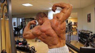 Massive mature bodybuilder gym posing