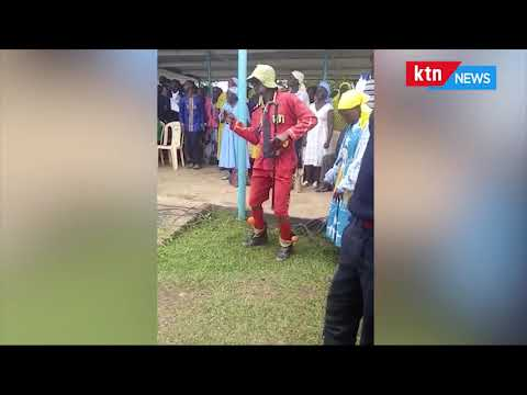 Man dances at the requiem mass for Adelaide, the first wife of Dr Boni Khalwale