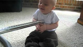Baby can t stop laughing at vacuum!