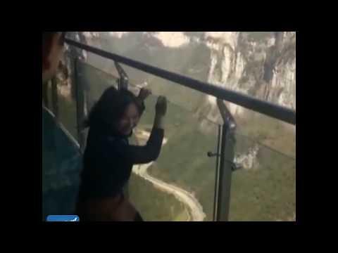 Terrified tourist dragged across glass walkway in Hunan, China