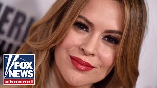 Alyssa Milano: 'Red MAGA hat is the new white hood'