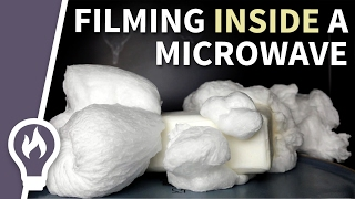expanding soap in a microwave filmed from in inside 1