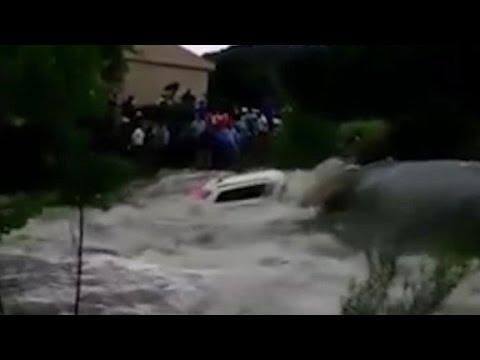Powerful flood sweeps SUV away