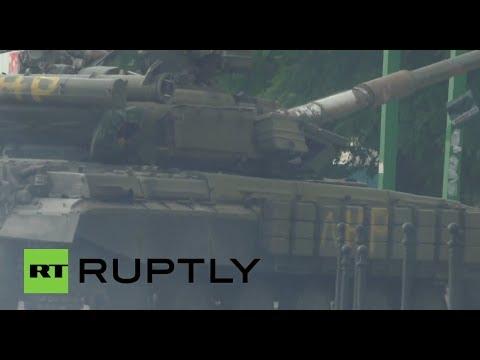 Caught on camera: E. Ukraine militia trucks, tanks & Grad rocket launcher vehicle in Lugansk
