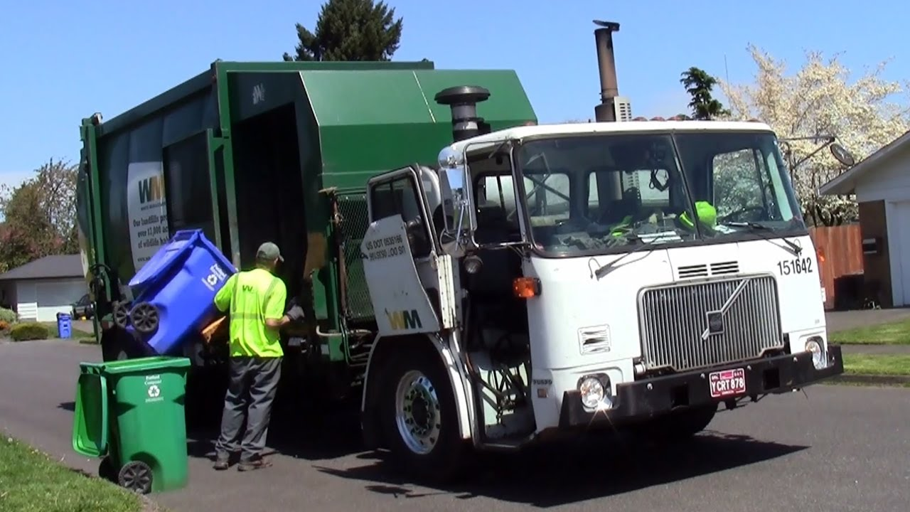 Volvo WXLL Wittke Express Manual Side Load Garbage Truck - YouTube