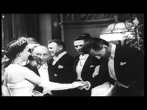 """Queen Elizabeth of England greets film stars at Royal Command Performance of """"Bea...HD Stock Footage"""