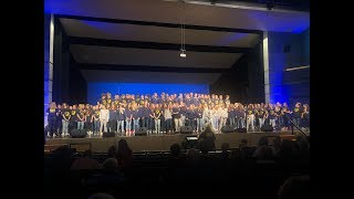 Grand Haven High School choirs sing 'I'll Make the Difference'