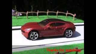 Matchbox Fisker Karma in red shining in the sun