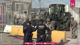 US soldiers add barriers at Mexico border as migrants approach