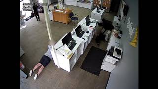 Surveillance video: Armed robbery at cell phone store (2of2)